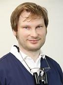 Dr. Adrian Lacher