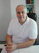 Dr. med. Alfred Naus